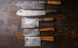 Butcher meat cleavers. Vintage Butcher meat cleavers on dark wooden background Stock Photography