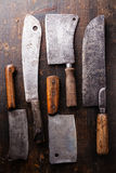 Butcher meat cleavers on wooden background Royalty Free Stock Images