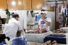 A butcher at a meat counter in Mercado Municipal Adolfo Lisboa in Manaus, Brazil Royalty Free Stock Image