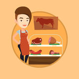 Butcher offering fresh meat in butchershop. Royalty Free Stock Photography