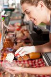 Butcher Packing Food for Customer Stock Photo