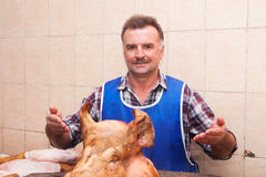 A butcher and a pig's head Stock Images