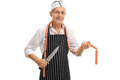 Butcher posing with a knife and sausages Royalty Free Stock Image