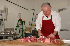 Butcher prepares boneless chuck roasts Stock Photography