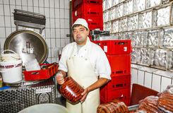 Butcher prepares fresh sausage Stock Photography