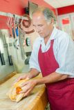 Butcher preparing a chicken royalty free stock image