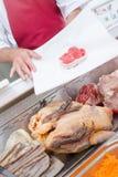 Butcher preparing customer`s order royalty free stock photos