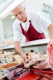 Butcher preparing his arrangement stock photos