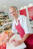 Butcher preparing joint beef in shop Stock Photo