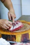 Butcher preparing pork spareribs Stock Images