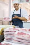 Butcher presenting fresh meat Royalty Free Stock Image