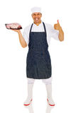 Butcher raw meat. Professional butcher holding raw meat isolated on white background Royalty Free Stock Photography