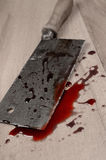 Butcher's cleaver. With blood on a wooden floor stock photos