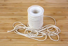 Butcher's cotton twine on cutting board Royalty Free Stock Photos