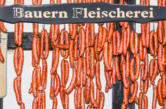 Butcher's Shop. Smoked homemade sausage hanging in a butcher's shop for sale Stock Images