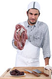Butcher with sausages Stock Photos