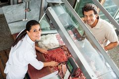 Butcher Selling Minced Meat To Male Customer Royalty Free Stock Photo