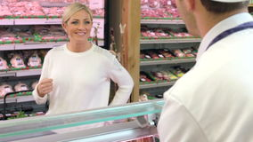 Butcher Serving Customer In Shop stock video