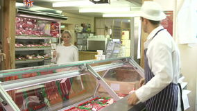 Butcher Serving Customer In Shop Royalty Free Stock Photos
