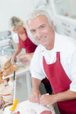 Butcher serving female customer Stock Images