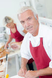 Butcher serving female customer Royalty Free Stock Photos