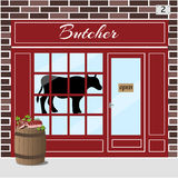 Butcher shop. Meat store. Butcher shop building. Cow sticker on window. Barrel with fresh slices of meat at the fore. Brown brick facade. Vector illustration Stock Photography