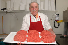 Butcher showing ground beef Royalty Free Stock Image