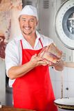 Butcher Showing Meat In Butchery Stock Photography