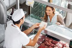 Butcher Showing Meat To Customer At Butchery Stock Image