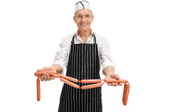 Butcher showing raw sausages Royalty Free Stock Photo