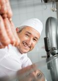 Butcher Smiling In Butchery Royalty Free Stock Photography