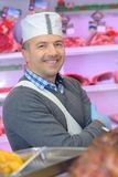 Butcher smiling and posing royalty free stock image