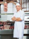 Butcher Standing Arms Crossed In Butchery Royalty Free Stock Photo