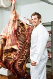 Butcher Standing in Cooler with Beef Royalty Free Stock Images
