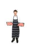 Butcher with trays of meat Royalty Free Stock Photo