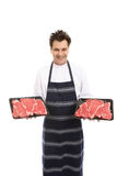 Butcher with trays of steak Royalty Free Stock Photo