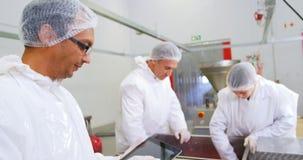 Butcher using digital tablet stock video footage