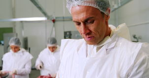 Butcher using digital tablet stock video