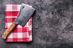 Butcher. Vintage butcher meat cleavers with cloth towel on dark concrete or wooden kitchen  board Stock Image