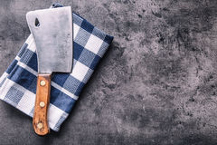 Butcher. Vintage butcher meat cleavers with cloth towel on dark concrete or wooden kitchen  board Stock Photography