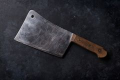 Butcher. Vintage meat knife. Over stone table. Top view Royalty Free Stock Photography