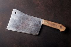 Butcher. Vintage meat knife. Over stone table. Top view Royalty Free Stock Photos