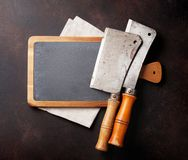 Butcher. Vintage meat knives. Over stone board. Top view with space for your text Stock Images