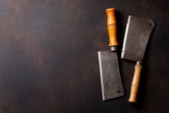 Butcher. Vintage meat knives. Over stone board. Top view with space for your text Stock Photo