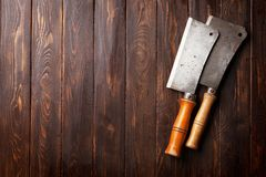 Butcher. Vintage meat knives. Over wooden board. Top view with space for your text Stock Image