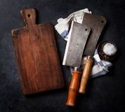 Butcher. Vintage meat knives, spices and board Stock Photos