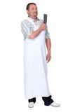 Butcher. Wearing a white apron stock photos