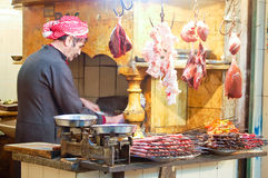 Butcher who is working his meat to prepare the skewers Stock Image