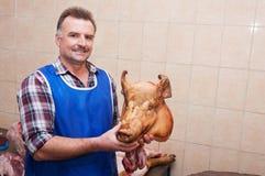 Butcher at work Stock Photos