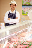 Butcher At Work In Shop Stock Image